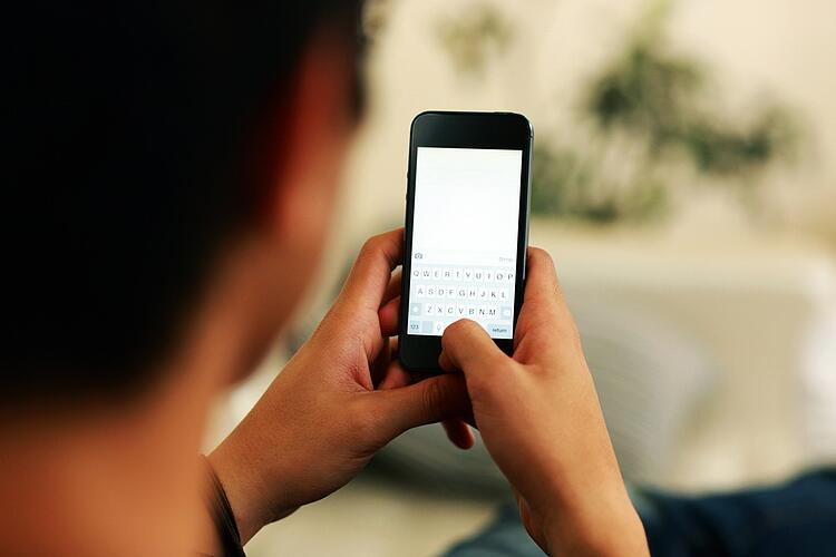 Closeup portrait of a man using smartphone