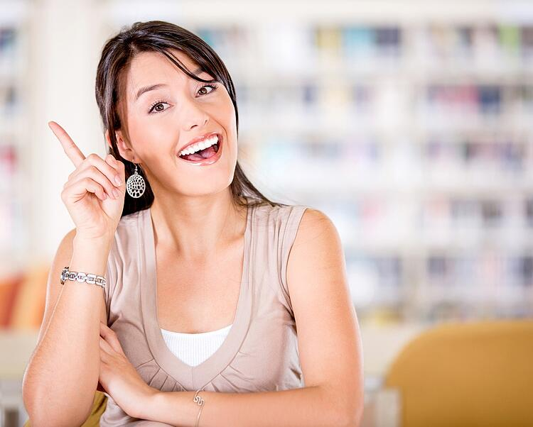 Female student pointing an idea looking very excited